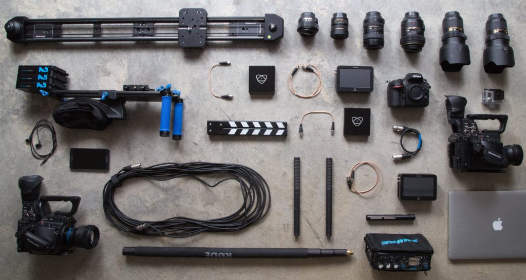Image of DSLR lenses and other camera equipment laid out