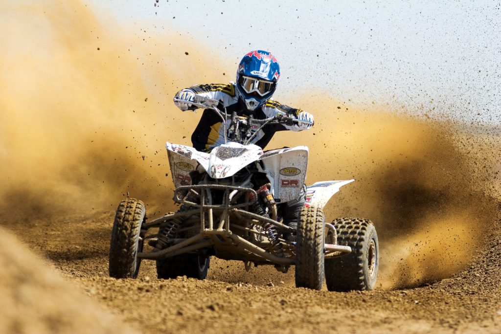 image of a person racing on a four wheeler showing the speed of DSLR cameras and their lenses