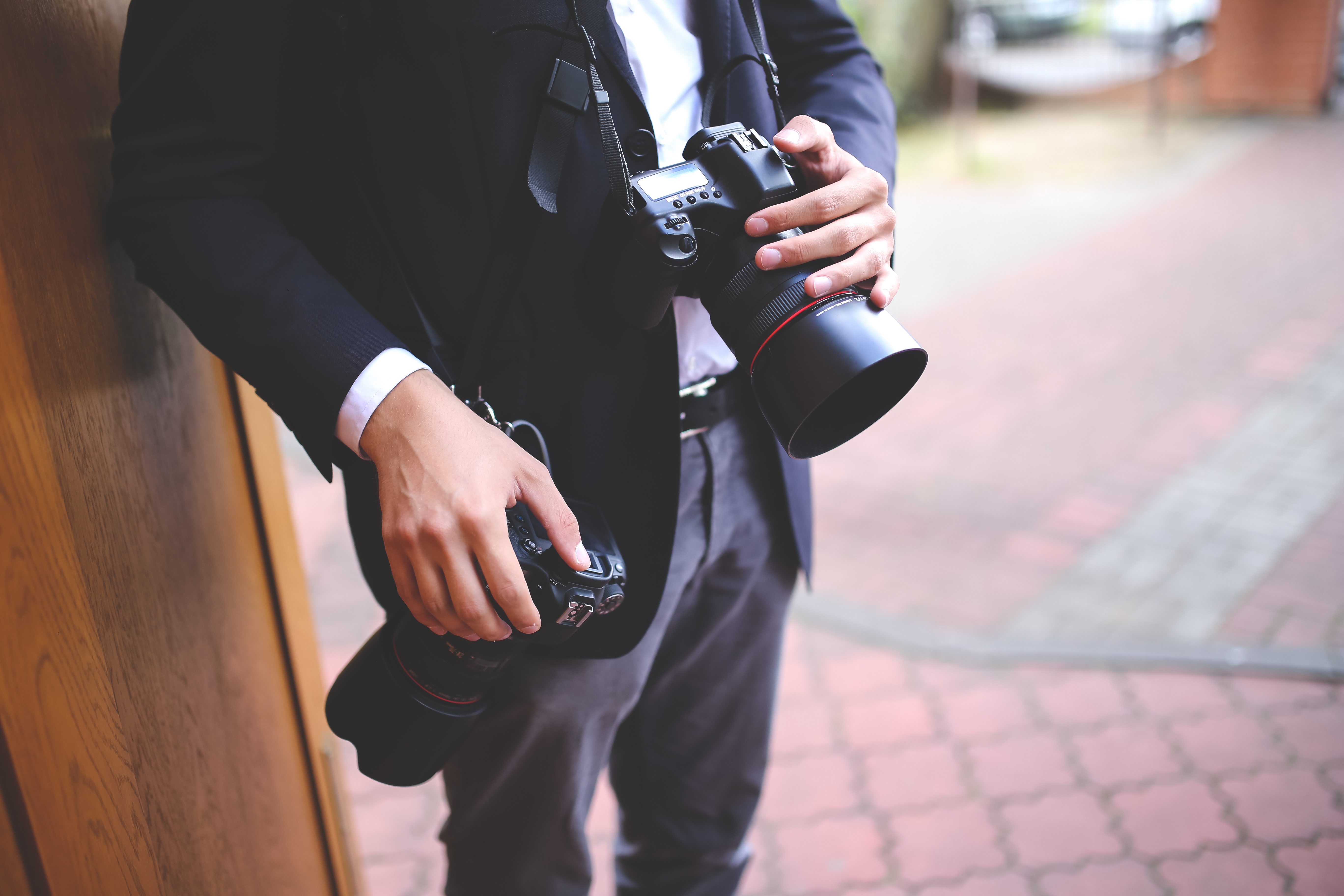 image showing a wedding photographer using two cameras
